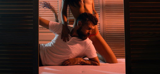 Obraz Man and intimacy. Bearded hipster feeling intimacy in bedroom. Bearded man and naked woman having bedtime routine for greater intimacy. Intimacy and intimate relationship with sex partner - fototapety do salonu