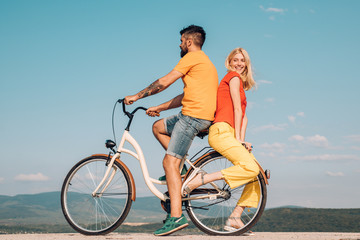 Married couple and sexual problems concept. Be Sensual. Couple In Love. Modern Trends. Summer love. Young lovers. Active couples. Young hippie couple on sky blue background