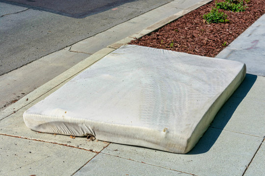 Old mattress dumped on the street. Illegal dumping disrupts natural land and water, harms plants and wildlife, causes health and safety hazards.