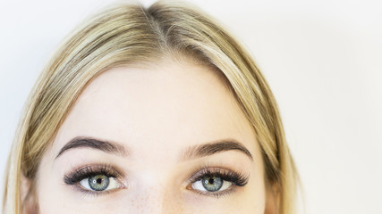 The girl's face is a blonde. Close-up. Facial care