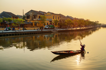 Awesome view of Vietnamese woman on boat at sunrise, Hoian