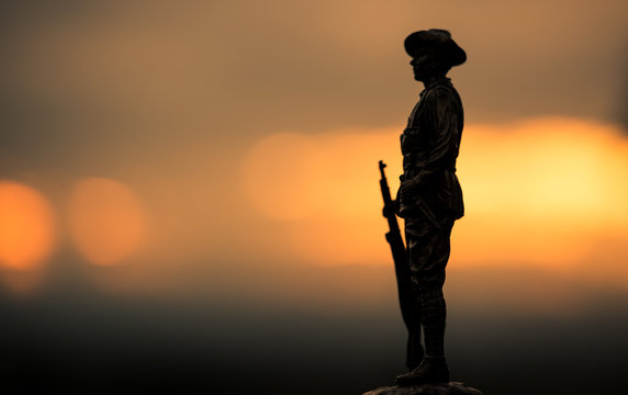 Soldier figure silhouette at sunrise, Anzac Day.