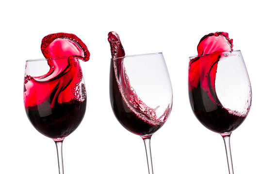 red wine in glasses with splashes on a white background isolated