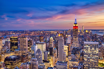 Foto auf Leinwand New York New York City Midtown with Empire State Building at Dusk from Helicopter View