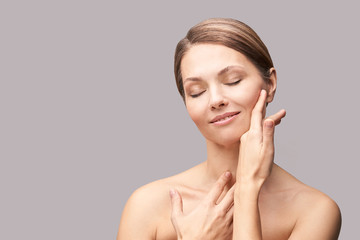 Natural beauty portrait with hands. Cosmetology mature woman face. Cosmetic cream. Skin care. Elegant girl