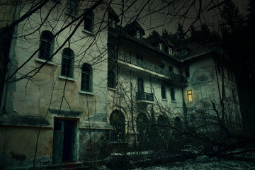 Old abandoned mansion in mystic spooky forest. The ancient haunted house of Frankenstein with dark horror atmosphere and creepy details