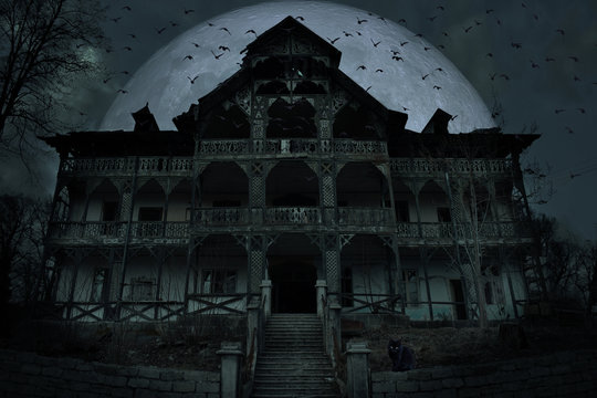 Abandoned old haunted house with dark horror atmosphere in the moonlight