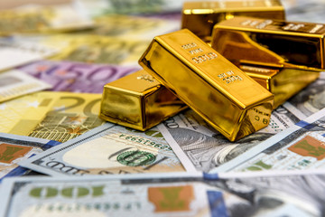Paper money and gold ingot, close up