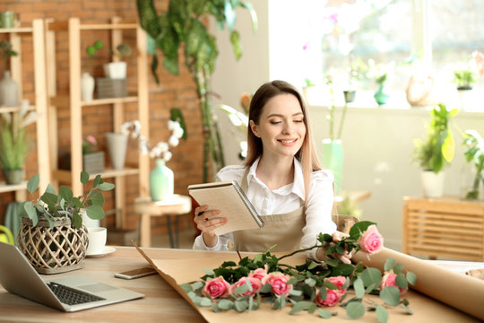 Young florist working in shop