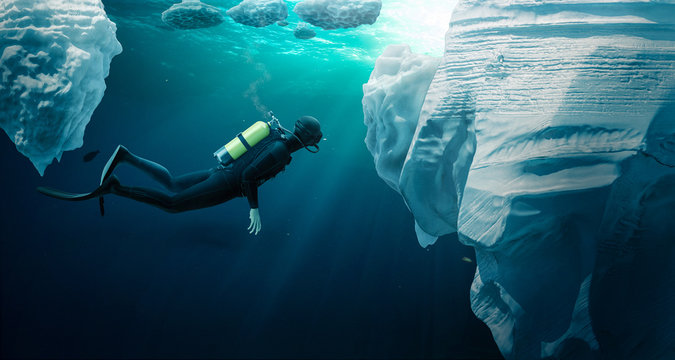 Diver ecploring the pack ice