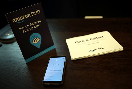 Amazon Counter branding, a click and collect service allowing customers to collect their Amazon parcels in-store at a Next store is seen in London