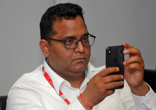 Vijay Shekhar Sharma, founder of Paytm's parent One97 Communications, checks his mobile phone before the launch of a Citibank and Paytm credit card in Mumbai