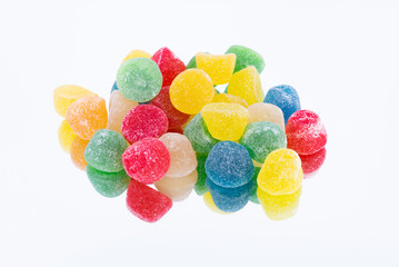 close up of gummy bear candies on white background