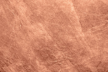 Abstract brushed copper surface metallic texture. Retro background