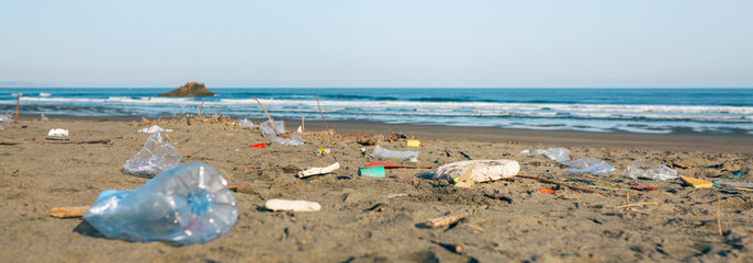 Dirty beach landscape full of waste without people