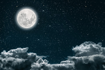 a backgrounds night sky with stars and moon and clouds.