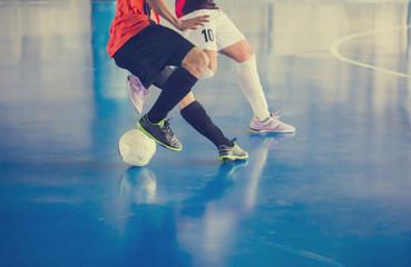 Indoor soccer sports hall. Football futsal player, ball, futsal floor