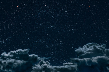 Wall Mural - a backgrounds night sky with stars and moon and clouds.