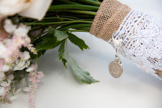 Sixpence goodluck charm on wedding flowers a tradition for good luck
