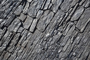 Obraz Vintage black coal wall,sunlit. Anthracite stonework - fototapety do salonu
