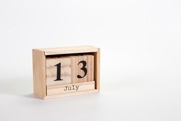 Wooden calendar July 13 on a white background