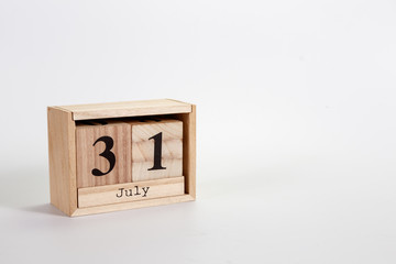 Wooden calendar July 31 on a white background