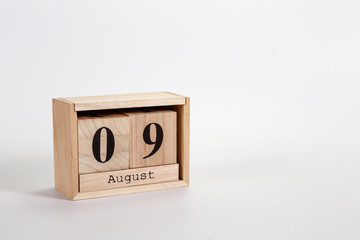 Wooden calendar August 09 on a white background