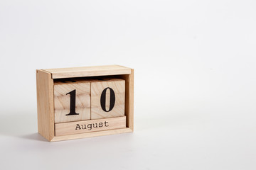 Wooden calendar August 10 on a white background