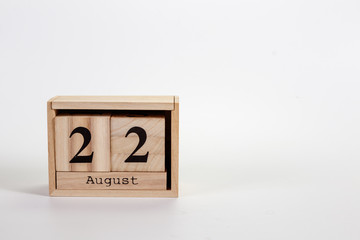 Wooden calendar August 22 on a white background