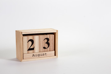 Wooden calendar August 23 on a white background