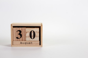 Wooden calendar August 30 on a white background