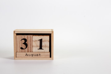 Wooden calendar August 31 on a white background