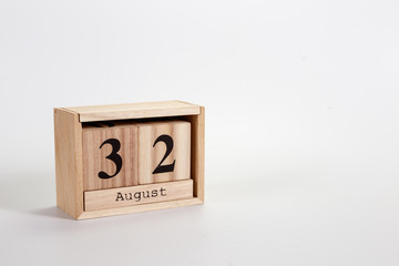 Wooden calendar August 32 on a white background