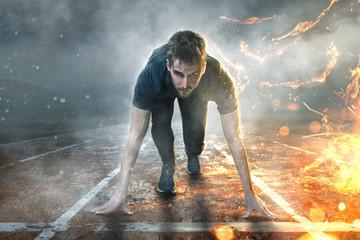 Läufer auf Laufbahn mit Wasser- und Feuereffekten