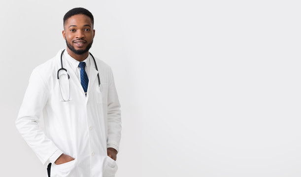 African Doctor In White Uniform Against White Background