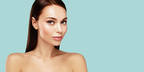Beautiful spa model with brown hair and  Clean Fresh Skin portrait. Skin care, Beauty treatment and  rejuvenation concept. Wall mural