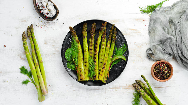 Green asparagus grilled with spices. Healthy food. Top view. Free space for your text.