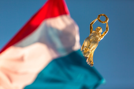 Iconic golden statue symbol of Luxembourg in Place de la Constitution