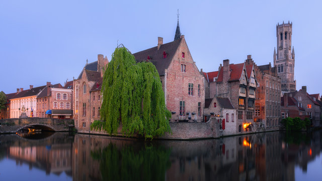 Medieval City Centre, UNESCO World Heritage Site, framed by Rozenhoedkaai canal at night, Bruges, West Flanders, Belgium, Europe