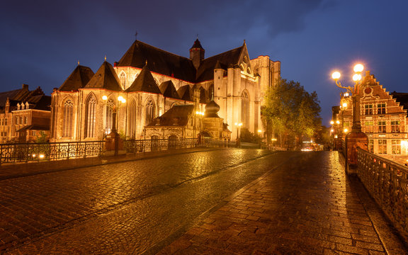 Medieval St. Michael Bridge, church and canal in Ghent, Belgium  at blue hour