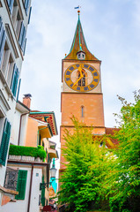 Wall Mural - Beautiful cozy street and tower of Saint Peter church in the city center of Zurich, Switzerland