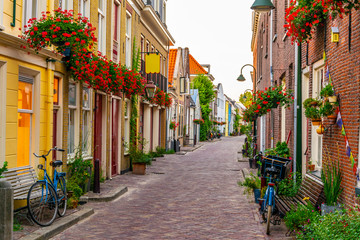 Narrow street in the center of Delft, Netherlands Wall mural