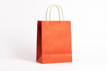 Orange shopping bag isolated on white background.