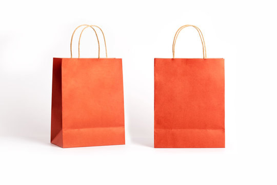 Orange paper bags isolated on white background.