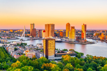 Sunset aerial view of Erasmus bridge and skyline of Rotterdam, Netherlands