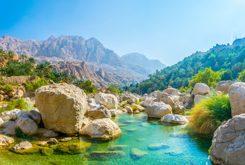 Poster Blauw Lagoon with turqoise water in Wadi Tiwi in Oman.