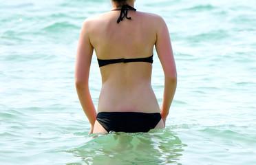 Women tourists She wore a black bikini southeast sea beaches.