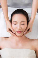 Fototapeta Ayurvedic Head Massage Therapy on facial forehead Master Chakra Point of Asian woman, Therapist Spa body woman hands treatment on customer to increase circulation release tension stress, isolated