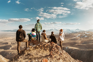 Group of tourists at mountains viewpoint Wall mural