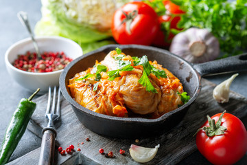 Cabbage rolls with minced meat and tomato sauce.